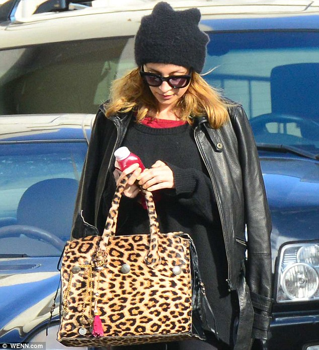 Nutritious: The 31-year-old star seemed to be clutching a healthy drink as she emerged from the gym