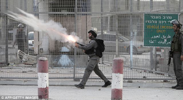 Israeli soldiers fire tear gas towards strone throwers in occupied West Bank