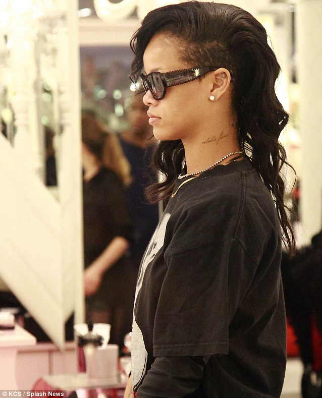 Instantly recognisable: Rihanna showed off her undercut hairstyle and covered up her eyes with sunglasses despite being inside
