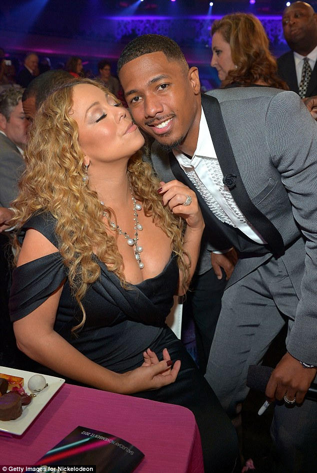 Feeling woozy: Mariah looks like she's about swoon over her man