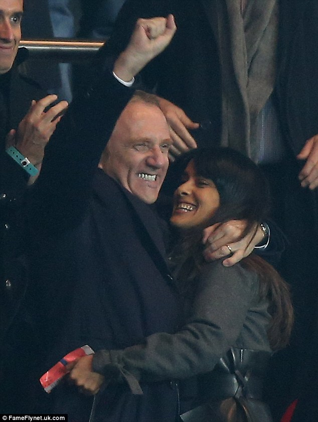 Winners: The couple are delighted when their team win the match