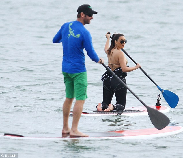 In unison: One of Kim's friends paddled around next to her