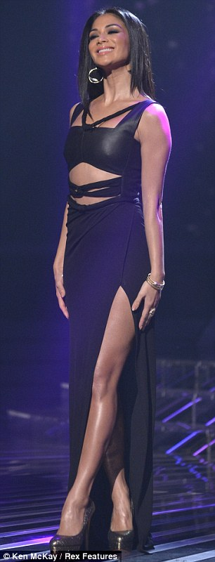 Thigh's the limit: Nicole Scherzinger shows off her long legs in a daring Osman Yousefzada dress, while Tulisa goes girlie in a Suzanne Neville creation on the X Factor results show