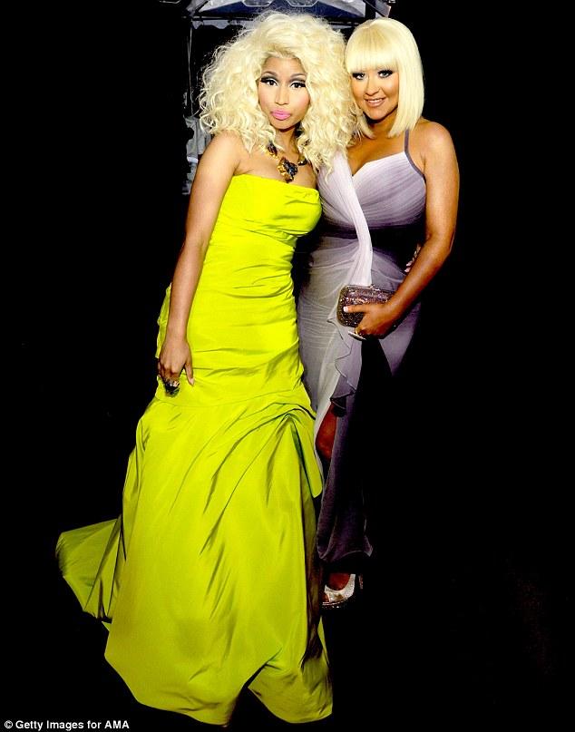 Bright night: Nicki, who is nominated for four awards, wore a neon dress while Christina slipped into a purple number split to the thigh