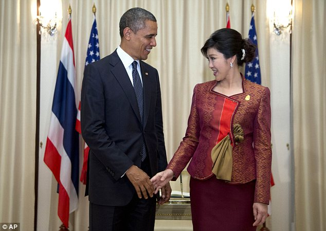 Why hello there: President Obama shakes hands with Thai Prime Minister Yingluck Shinawatra as he arrives at the Government House in Bangkok, Thailand