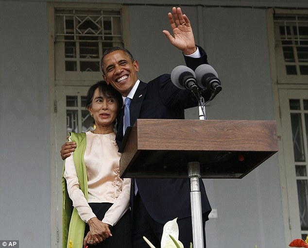 Together: Obama embraces Suu Kyi in Yangon, where he praised Myanmar leaders for their reforms