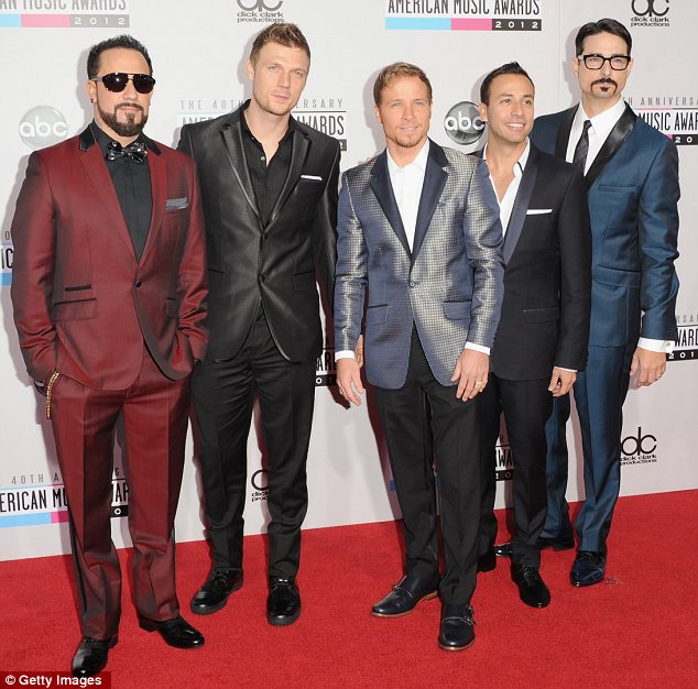 Backstreet's back alright: The Backstreet Boys even took the boyband approach of sporting matching suits in different colours