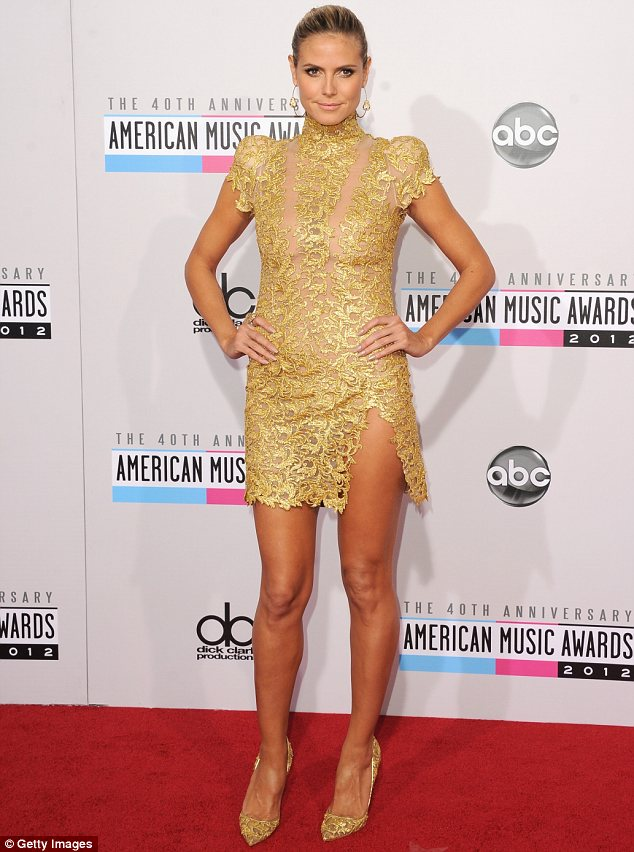 34f5a39dca6af Golden girl: Heidi Klum was the centre of attention in her revealing gold  brocade dress at the American Music Awards on ...