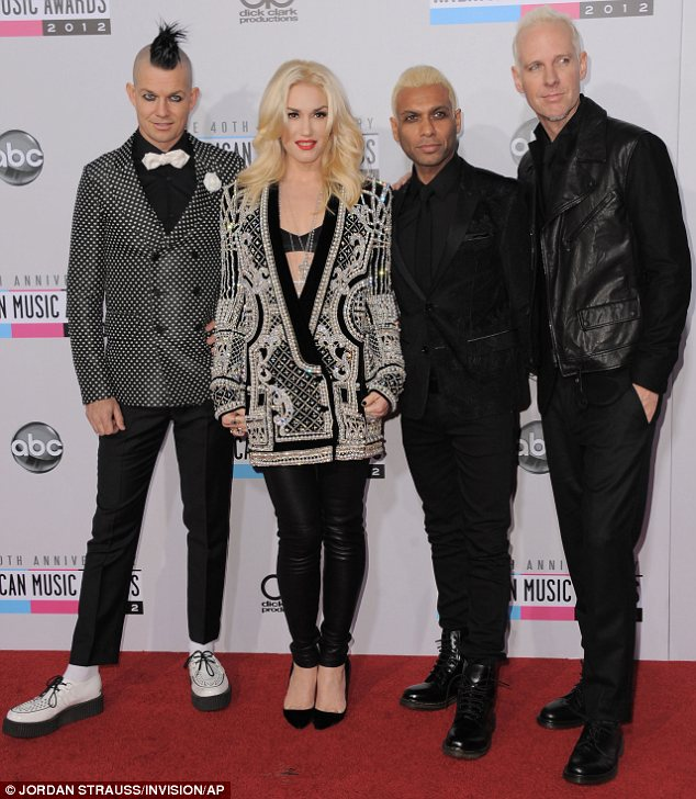 She can work anything: Gwen Stefani was very dressed down in leather trousers and an oversize jacket to pose with the rest of No Doubt, but as always looked amazing