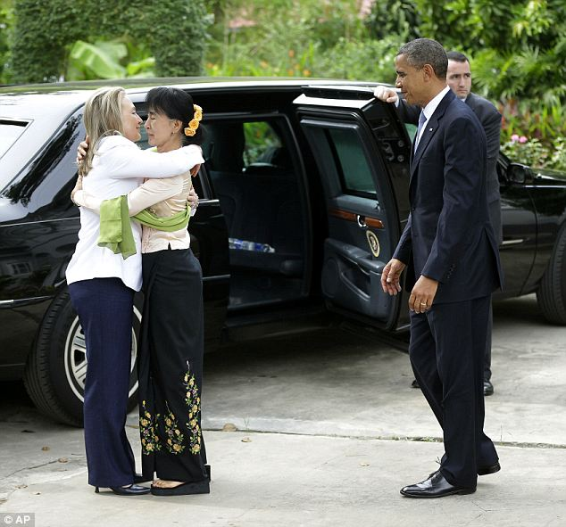 Friendly reception: Hillary Clinton gives Aung San Suu Kai a big hug after arriving with President Obama at her residence in Yangon, Myanmar on Monday