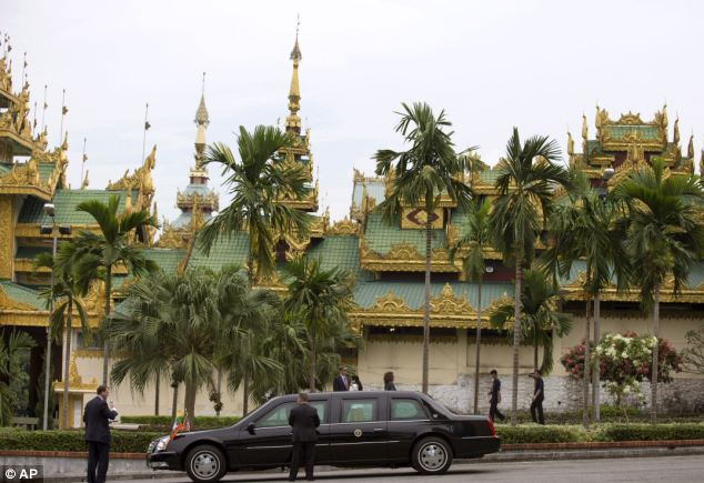 Waiting: Obama's motorcade is parked outside the Shwedagon Pagoda as he takes a tour