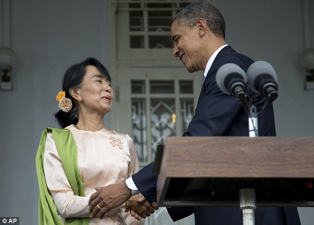 Affectionate: Obama and Suu Kyi shake hands after speaking at her residence in Yangon