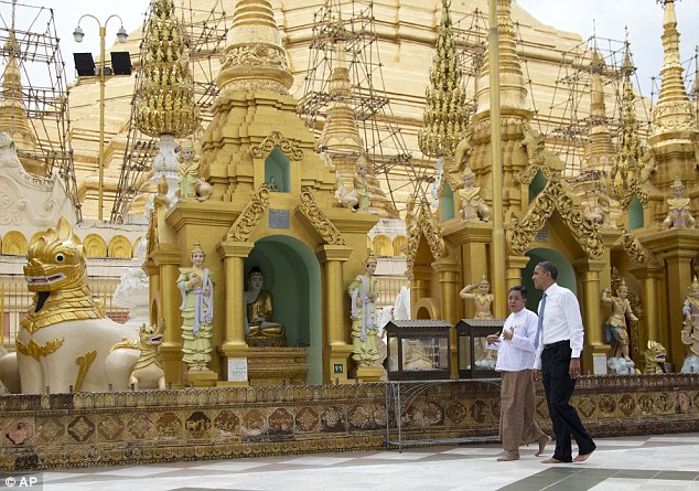 Opulent: Obama tours the Shwedagon Pagoda in a U.S. president's first visit to the country