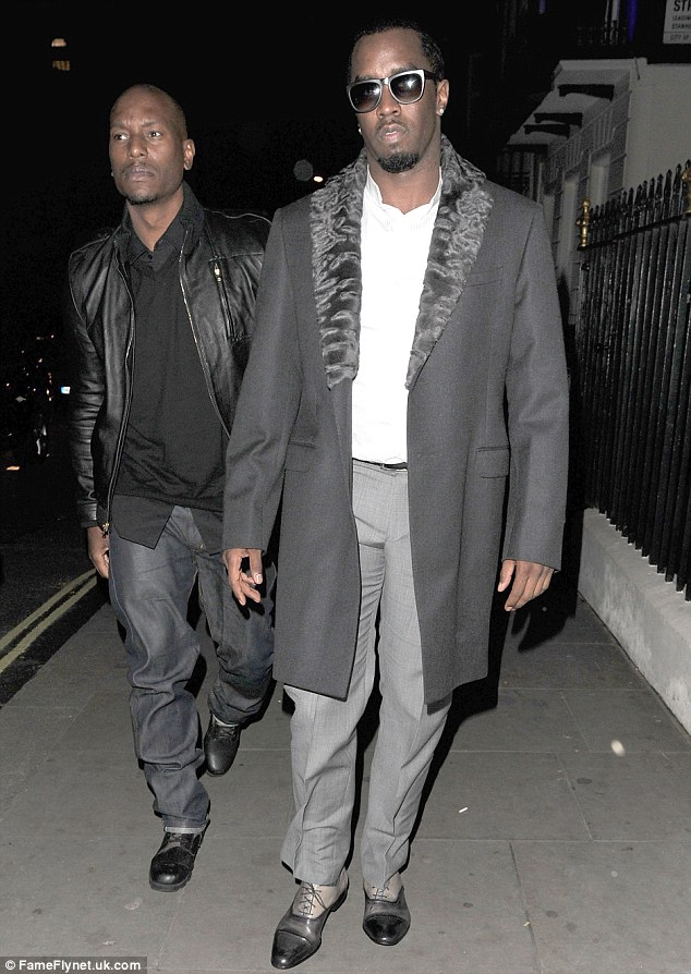 Dapper: P Diddy looked smart as usual in his grey suit trousers and long coat, with a fur lined collar to keep out the cold