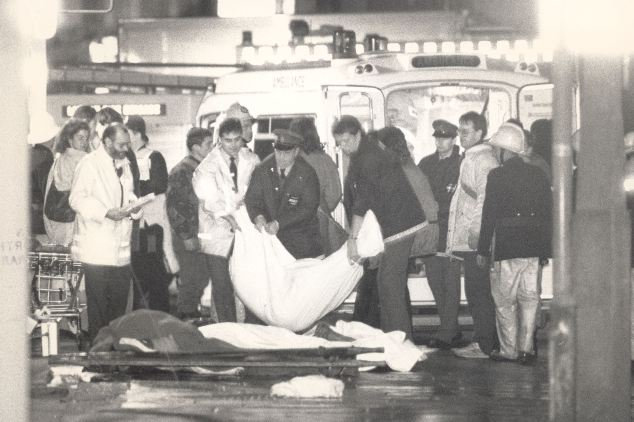 Tragic: Burnt bodies are loaded onto ambulances outside the station after the fire killed 31 people