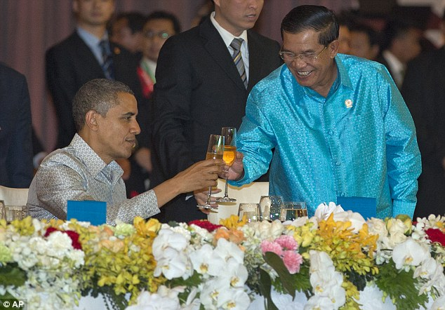 At ease: Obama toasts with Hun Sen at the East Asia Summit Dinner despite their 'tense' talks