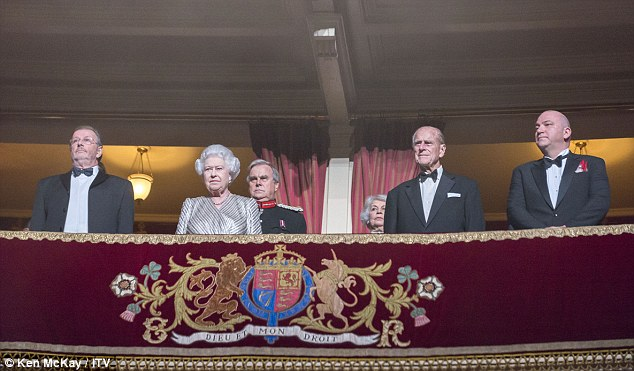 Taking her seat: The Queen took her place next to the Duke of Edinburgh as they watched the show unfold
