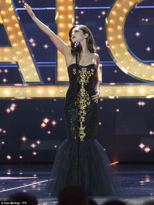Giving it her all: Cheryl stood in the middle as they gave their best efforts on the night