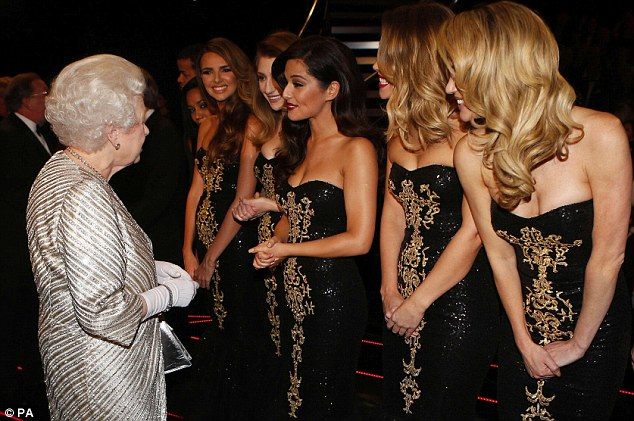 Having a chin wag: The Queen greeted the girls after the show to thank them for their efforts