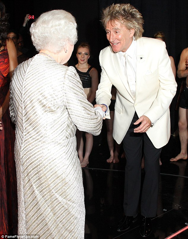 Pleased to meet you: Rod Stewart bowed as he shook hands with Her Majesty