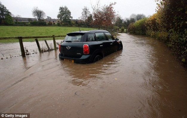Mini adventure: The heavy rain has brought widespread disruption to many parts of the UK particularly in Somerset and Wiltshire