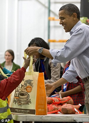 President Barack Obama distributes food