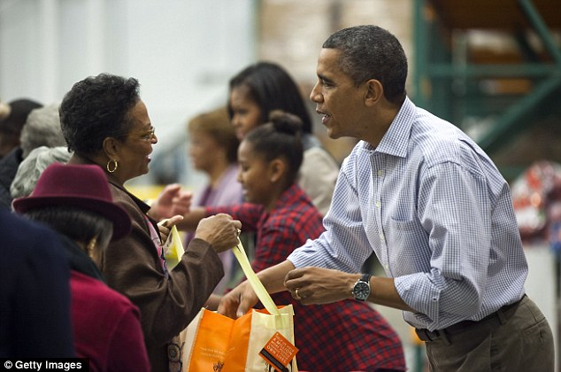 Family tradition: The Obamas have been volunteering at the DC food bank since 2008