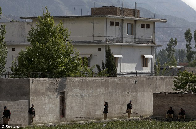 Stronghold: Members of the anti-terrorism squad are seen surrounding the compound where bin Laden was killed by Navy SEAL Team 6 in Abbottabad May 4, 2011