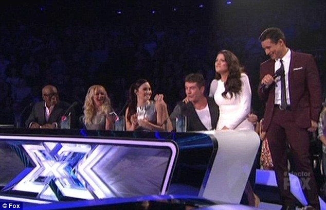 Shocked: Fellow judge Demi Lovato made fun of the British judge as Britney Spears looked shocked and L.A Reid laughed