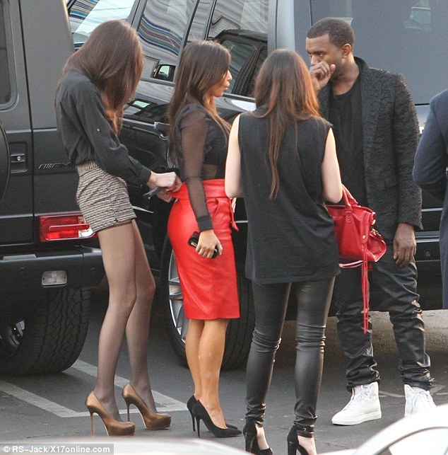 Part of the family: Kanye seems relaxed and happy to hang out with his girlfriend's family