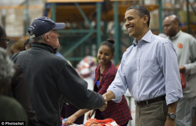President Obama, pictured at a Washington food bank, called 10 members of the armed services in Afghanistan