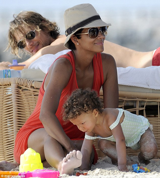 Happier times: Halle, Gabriel and Nahla seen in a cute beach snap in Miami back in 2009
