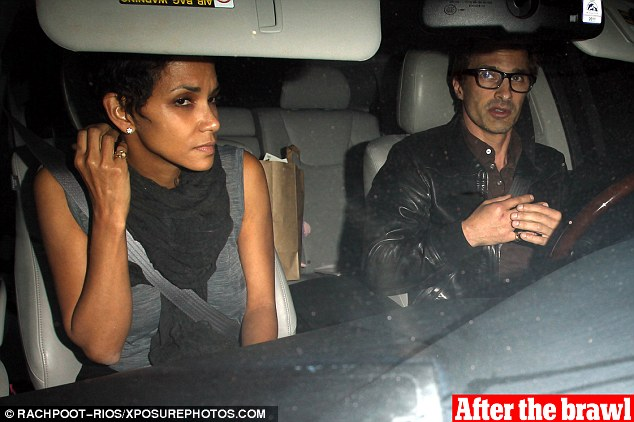 Eventful: Halle Berry and Olivier Martinez looked furious as they headed home from hospital after the brawl on Thursday