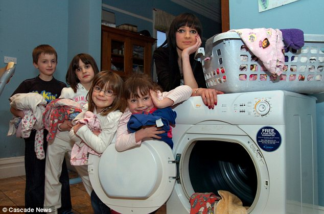 What a load: James, eight, Katie, nine, Ellie, seven, Aimee, 11, and Chloe, 17, with their washing at the family's industrial-sized machine