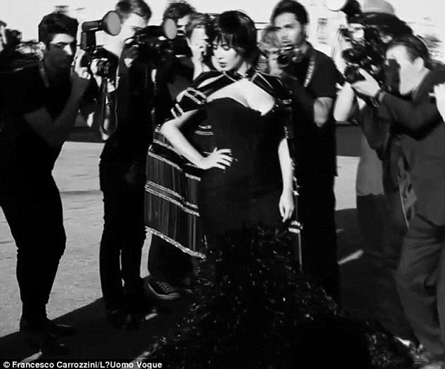 Italian job: Kim wore this black sleeveless Mark Zunino Couture gown that showcases her famous curves for the Vogue Italia shoot