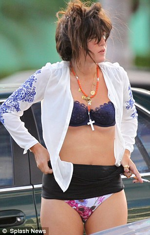 Quick change: Paz stripped off her bikini bottoms in the middle of a public car park in Miami on Friday