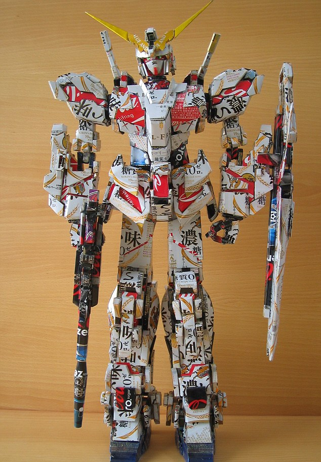 Transformed: An armed Decepticon created from the cans by the Japanese artist Macaon