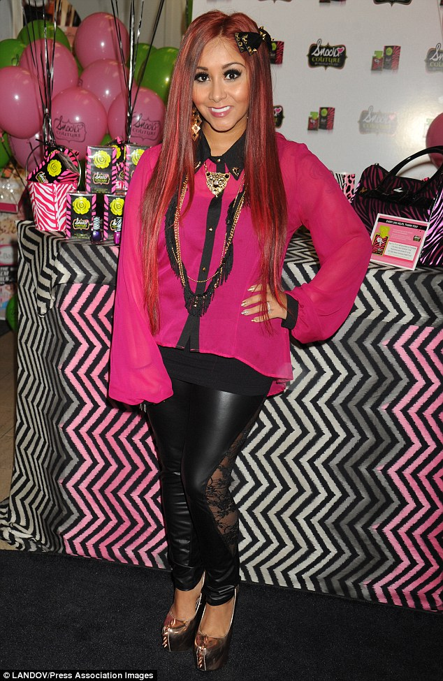 Snooki Promotes Her Perfume Line But Still Shows Off