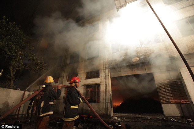 Tragic: Firefighters try to control a fire in a garment factory in Savar, on the outskirts of Dhaka