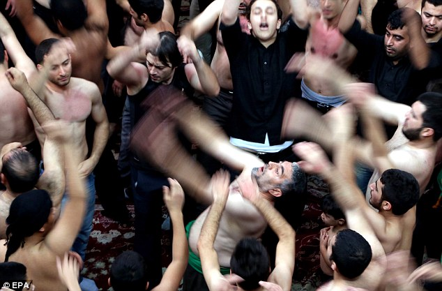 Mourning Iraqi Shiites at the Ashura ceremonies at the Kerbala mosque in Tehran, Iran