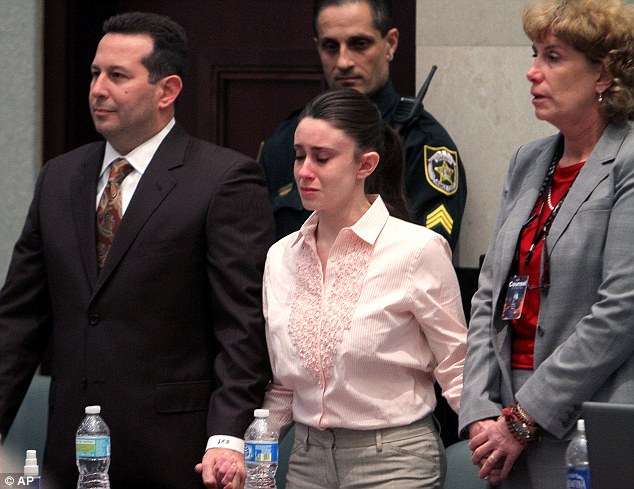 Acquitted: Casey Anthony reacts as she is found not guilty in the murder of her daughter Caylee. She is flanked by her attorneys, Jose Baez, left, and Dorothy Clay Sims, right