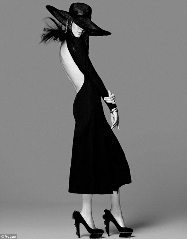 Hats off: Kendall posed for this striking shot in a black hat, backless midi-dress and striking black heeled shoes