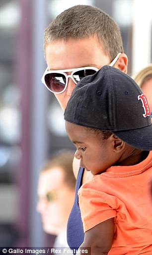 Doting mother: The star kept a close eye on her son Jackson as she stepped out in Green Point, South Africa