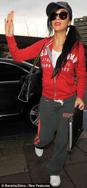 Style swap? Nicole Scherzinger and Tulisa Contostavlos seem to have swapped wardrobes in the past 24 hours, with Nicole opting for a casual tracksuit and Tulisa taking on a totally uncharacteristically ladylike number