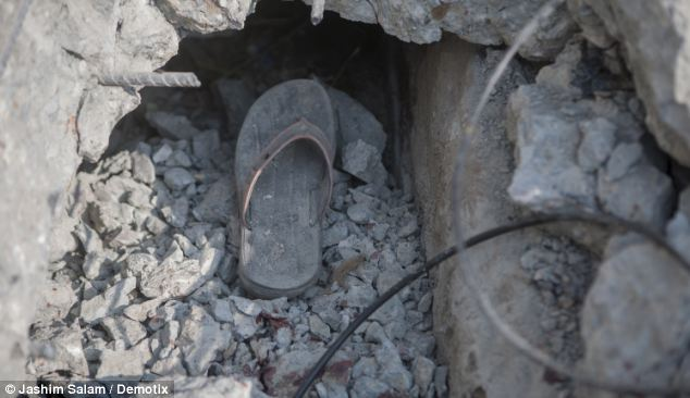 Carnage: A slipper and a blood stain in the rubble of the overpass
