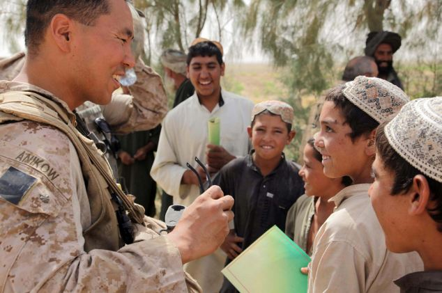 Stabbed: U.S. Marine Major George Anikow (left) served as a civil officer in Afghanistan's Helmand Province in 2009 before moving to the Philippines, where he was killed at the weekend