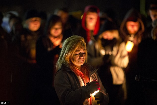 Remembered: At a candle-lit vigil on Sunday, Rachel Brady speaks about her brother Nick to the crowd