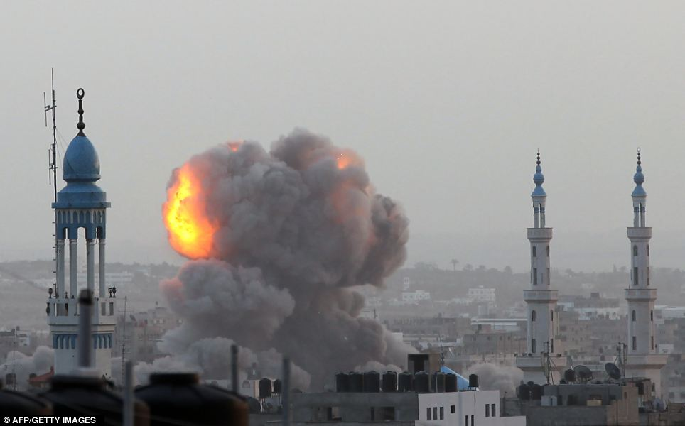 A fire ball rises over the city of Gaza as the Israeli air force carries out a raid in November