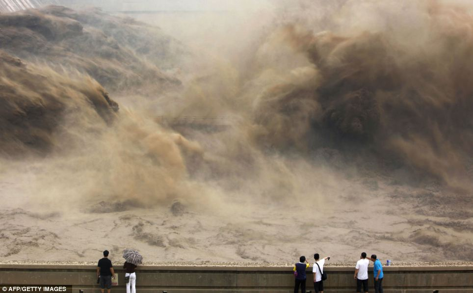 In July, visitors to central China's Henan province gathered to watch giant gushes of water get released from the Xiaolangdi dam to clear up the Yellow river and prevent localized flooding