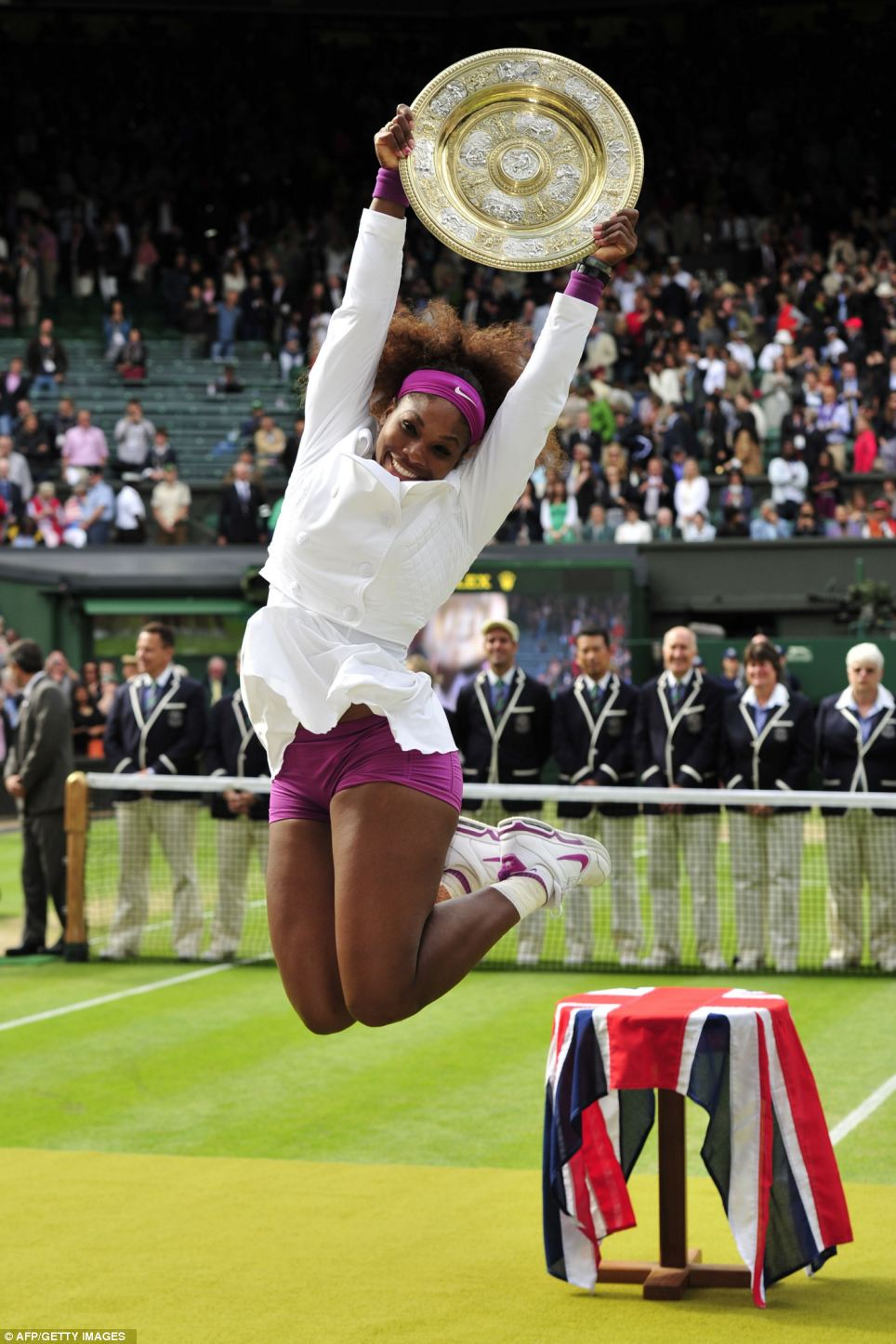 Serena Williams celebrates her victory after the women's singles final on day 12 of the 2012 Wimbledon Championships tennis tournament